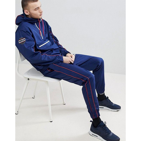 Blue men tracksuit with red stripe and drawcord